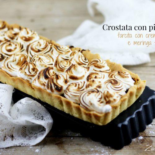 Crostata di Iginio Massari con pinoli, semi di papavero, crema gianduia e meringa flambé