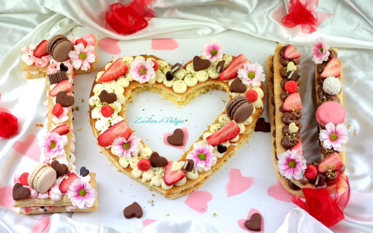 Cream tart per san valentino i love u zucchero e valigia for Case a forma di u